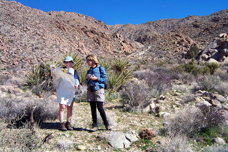 Kathy and Sooz check the map before we start up the canyon. We are at 3,700' here.