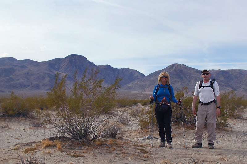 Sooz and Joe(me) at the start of the hike just off the Pinto Basin Road. Mary Peak is the high peak near the center of photo.