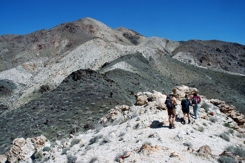 Getting closer to the summit which is behind the peak in back.