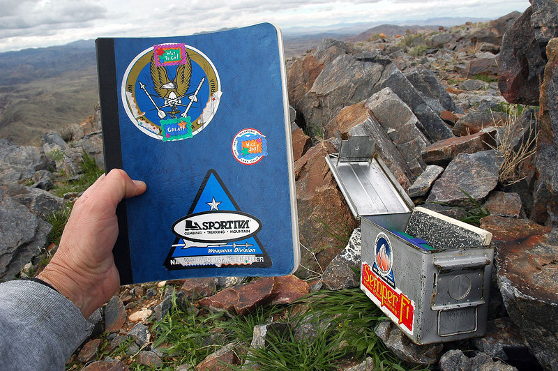 One of the summit registers. Someone put stickers covering the military ones.