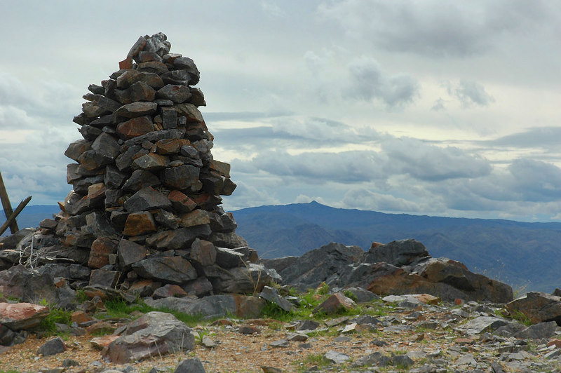 The summit cairn with Monument Mountain in the distance.