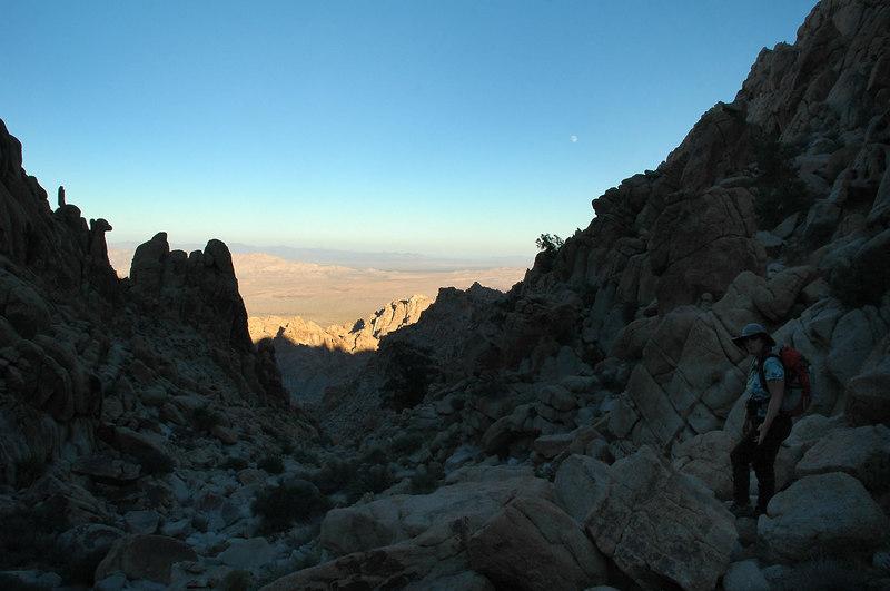 Climbing down the rocky canyon.