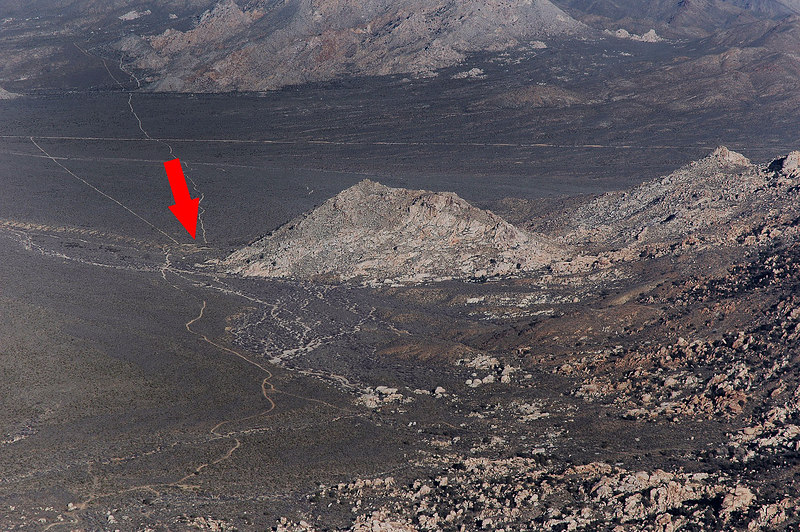 Zoomed in on the trailhead. The arrow points to our trucks.