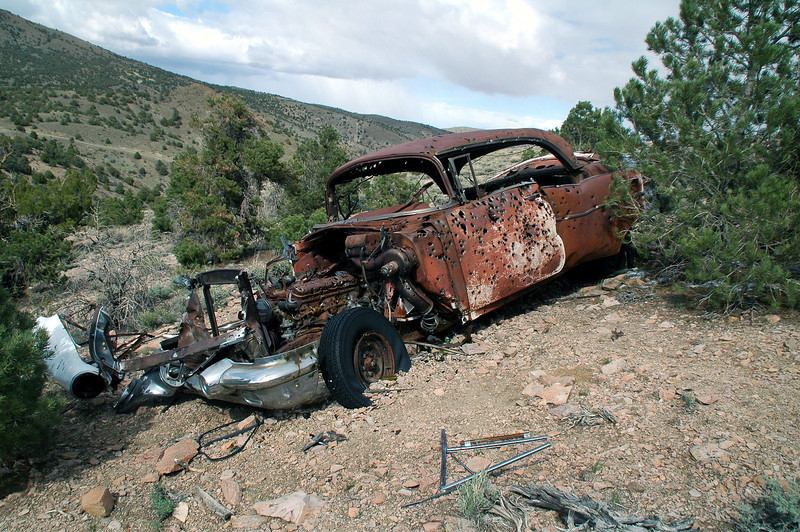 Like most old vehicles out in the desert, it was full of bullet holes.