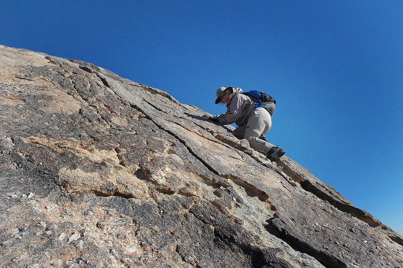 Kathy climbing towards the peak.