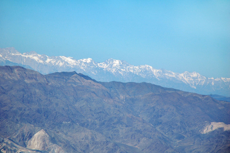 Zoomed in on the snow covered Sierra Mountains.
