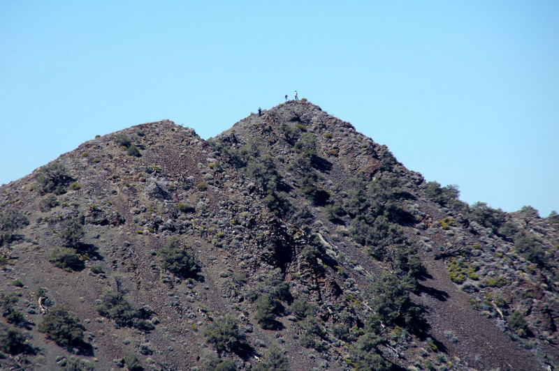 Zooming in on the peak, I could see two of the guys on it's summit and another one about there.