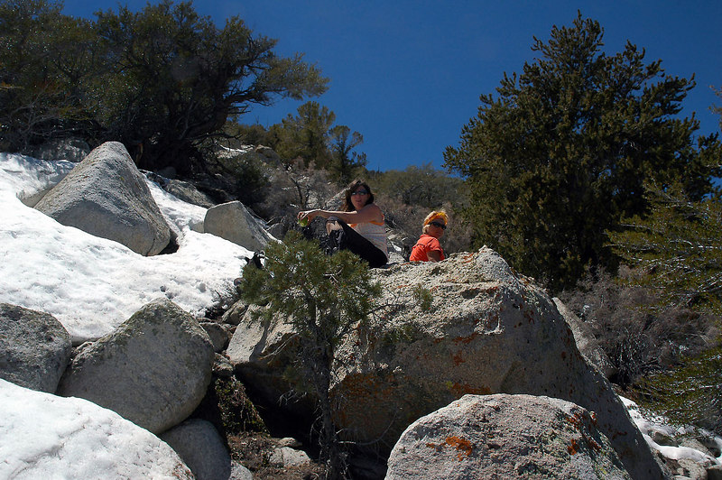 Susan and Sooz on the rocks above. We been coming across patches of snow to this point. They were small enough to just go around them.