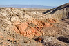 Looking back at the red clay formation. This may once have been a spring, with dissolved minerals in the water staining the clay red.<br /> <br /> The Salton Sea is visible in the distance.