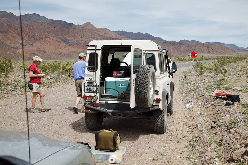 It turned out Jim's engine had sputtered and quit on Saratoga Springs Road, shortly after crossing the Amargosa River. Bill towed him several miles out to the main highway to Ashford Junction.<br /> <br /> We thought it was all over. It seemed to be the fuel pump, which is mounted above the gas tank. No way to make a field repair on that. Time to drive to Shoshone, get a tow truck and make the long sad ride back to Baker for repair. End of the trip... Oh well, it was bound to happen sooner or later. We have had pretty good luck over the years.