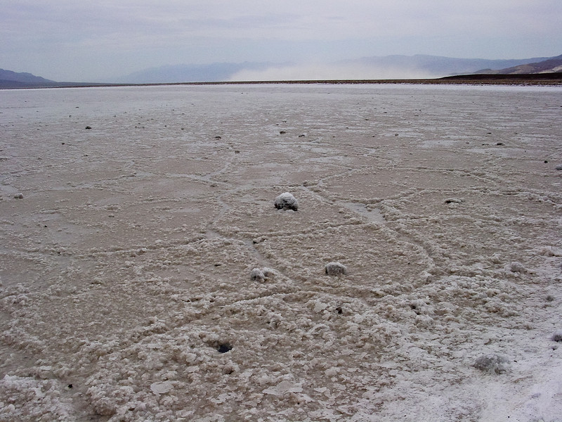 Salt pan with dust storm in the distance