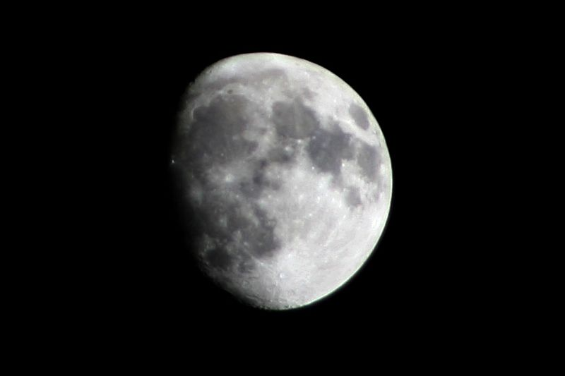 My light source for the evening. <br /> <br /> Another attempt at a moon shot. Better than the night before. Mid-way between first quarter and full moon.