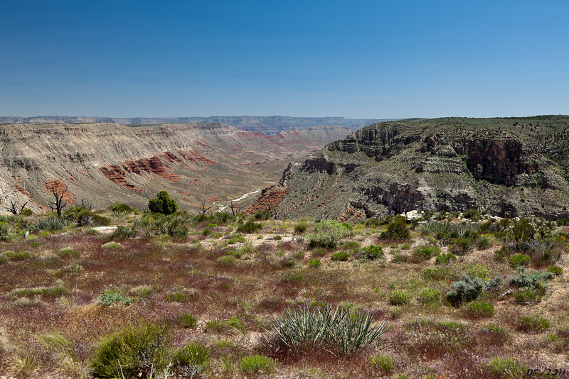 Mule Point, looking down into upper Parashant Canyon<br /> <br /> Whitmore point is at the end of the ridge on the left, the south rim of the Grand Canyon in the far distance