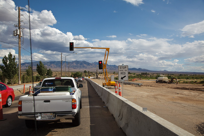 The last traffic light (and paved road) for a week<br /> <br /> This interesting portable light was controlling one-way flow across a new bridge being built over the Virgin River.