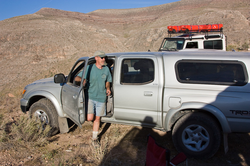Having failed to get through from the mine to the top of the plateau, we reluctantly backtracked to the saddle to make camp for the night.<br /> <br /> I don't have any photos of our attempts to get through because we were too busy moving rocks, and my camera was all the way at the bottom in Peter's truck. Dam'n it was hot! When we got back down to the saddle, I drank two quarts of water while we waited for the others to show up. <br /> <br /> As it turned out, Will had sliced open a tire on a sharp rock, and they all had to change the tire on the steepest part of the cliff-side road.