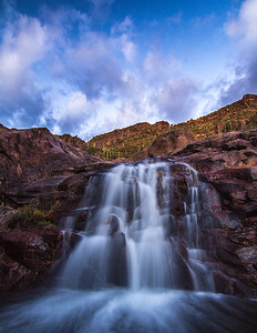 Seasonal waterfall below the petroglyphs along the Hieroglyphics Trail. Captured at dusk.