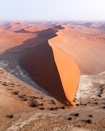 Aerial image of Sossusvlei, Namibia, at sunrise.