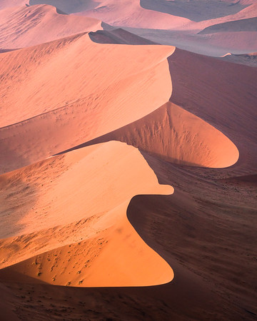 Aerial image of the dunes in Sossusvlei, Namibia, at sunrise.