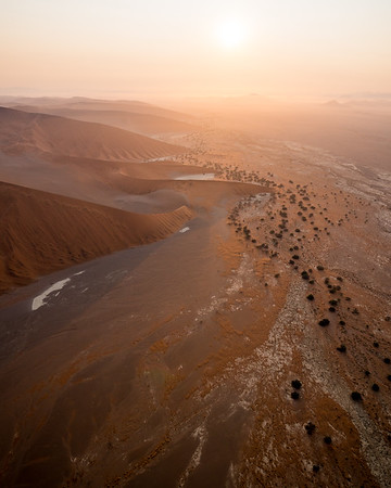 Aerial image of Sossusvlei, Namibia, at sunrise.