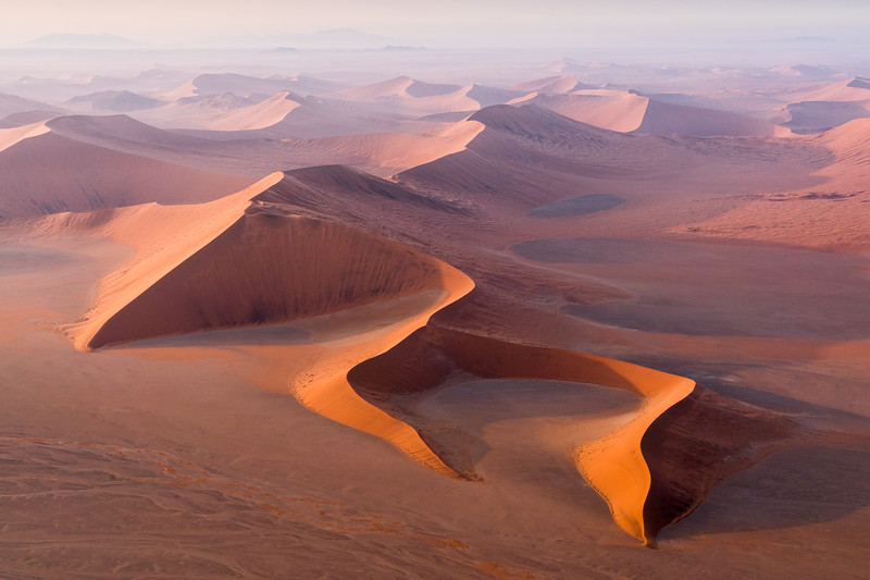 Beautiful dunes in Sossusvlei, Namibia, seen from a helicopter at sunrise.