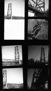 Once again I ruined the first frame, didn't realize I had the shutter on T and it was open when I loaded the film.  Then overexposed the first three frames about half a stop.  Next two came out just about perfect (upper right) but then moved into the shadows and didn't compensate fully resuling in two underexposures.