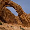 Man Swinging From Natural Arch in Utah