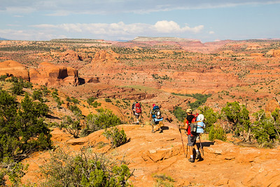 The Pack In hike from the Egypt Trail head with Excursions of Escalante. In the distance looking out over the Escalante River Canyon towards the Henry Mountains.