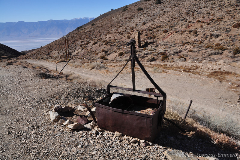 Old mining equipment is scattered - some as decoration, some like junk.
