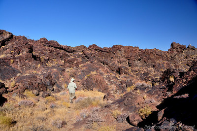 Heading back to the top of the falls via the maze of lava rock