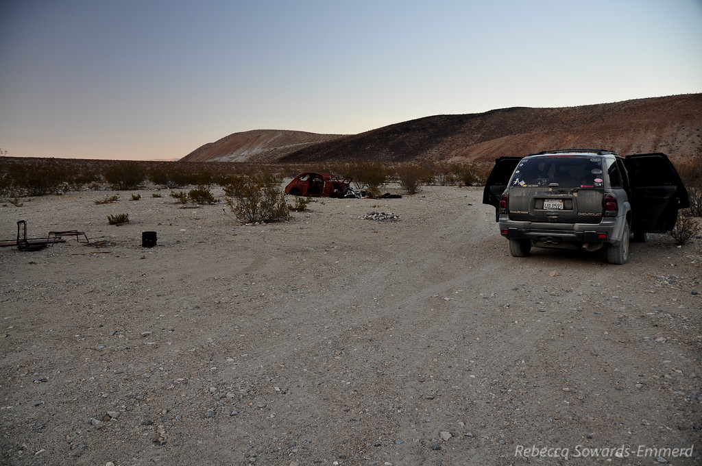 Our campsite (and dusty truck). Hope it doesn't end up like the rusted WV in the background.
