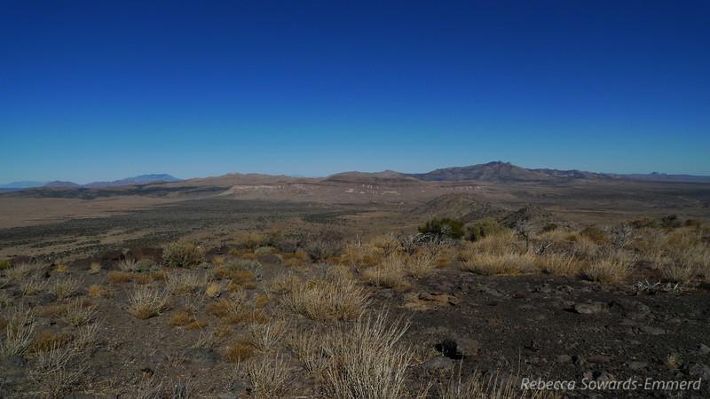 Views across the summit to Pinto Peak