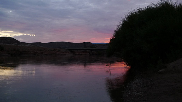 After spending our afternoon enjoying fall colors in the Rockies we drove down towards Moab and camped along highway 128 next to the Colorado River. This is sunset from our campsite right on the river. Nice!