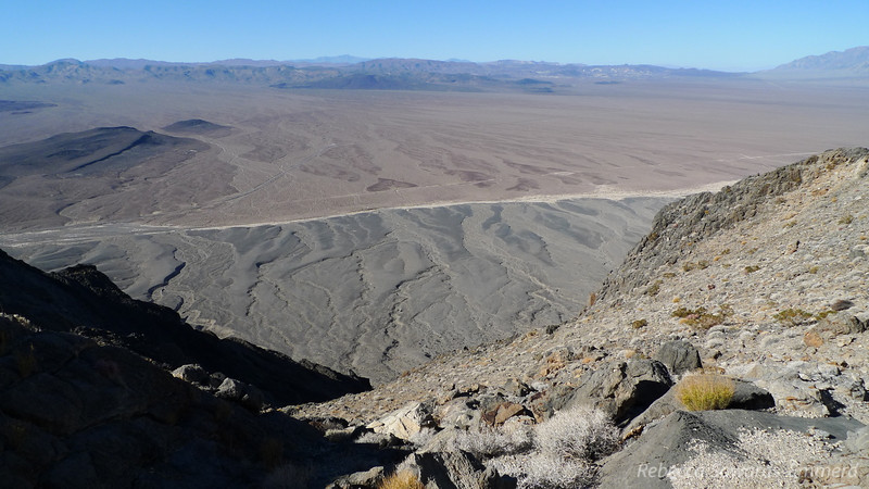 Resting at the notch. The light strip is the Amargosa river, and our trucks are down there somewhere.
