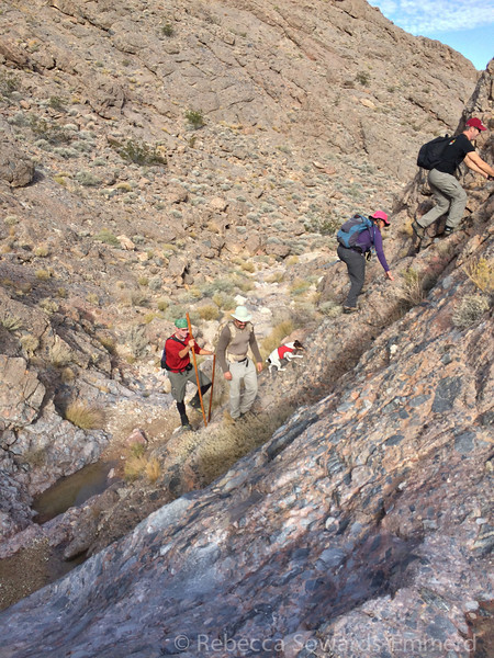Scrambling up the end of a canyon near a dry fall.