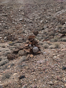 Some large cairns/rock piles along the way, but they didn't seem to mark any kind of route. Probably a relic of the mining in the area.