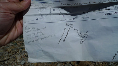 I found the summit register about 100 feet down off the side of the mountain. Brought it back up. Someone had put a AAA map in it as the register. Needs a book.