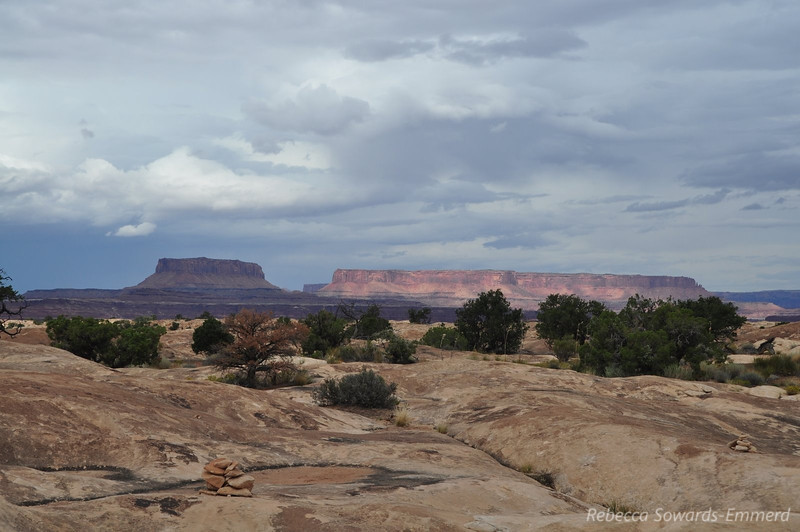 Sun breaking through storm clouds. Slickrock Trail, Canyonlands National Park Needles District