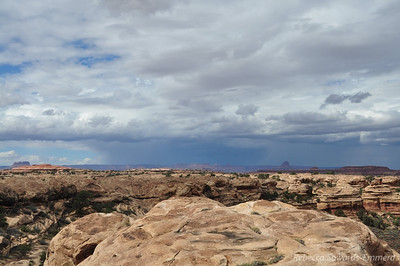 Storm moving out. Incredible lightning, wish I caught a bolt on camera. Slickrock Trail, Canyonlands National Park Needles District