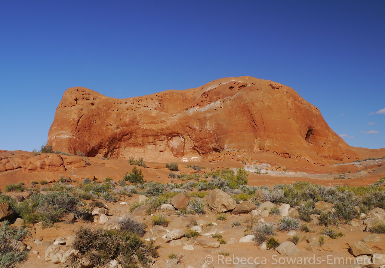 This is a huge red rock with a natural amphitheater in the side.