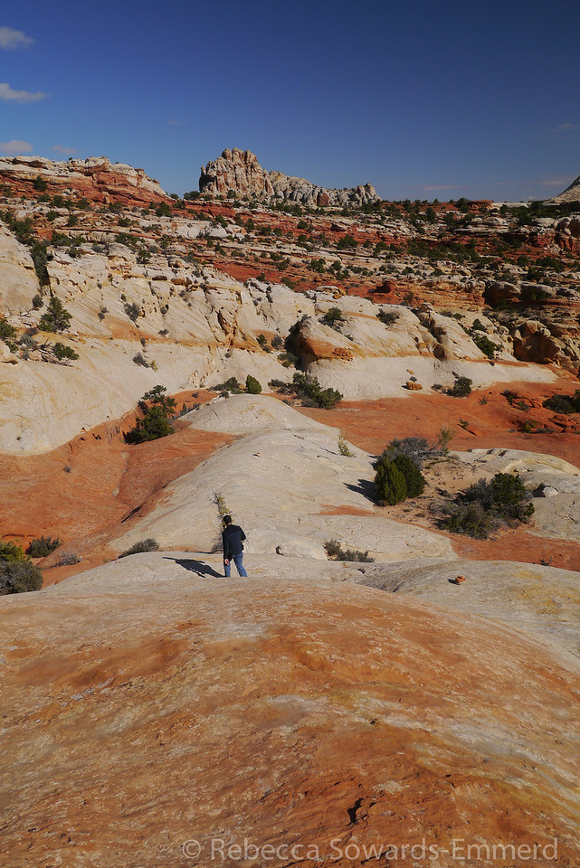 Hiking back from the arch across the grippy sandstone.