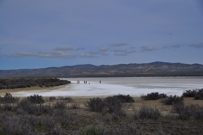 People on the dry soda lake