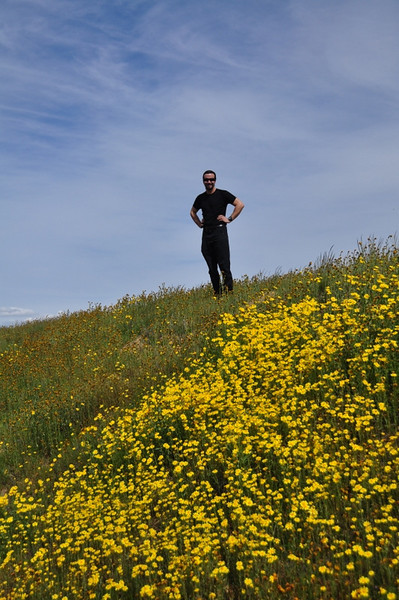 We quickly come across more goldfield. David is happy. I dare you to stand in a field of beautiful wildflowers and try to NOT smile!