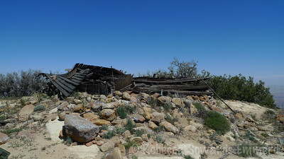 Collapsed cabin on the summit of Caliente. I read this was an old WWII lookout.