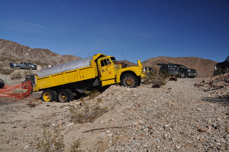 Stranded mining truck (yellow) and our own stocker that made it in here (black). Hope we make it back out - the shelf road in here was...uh...fun.