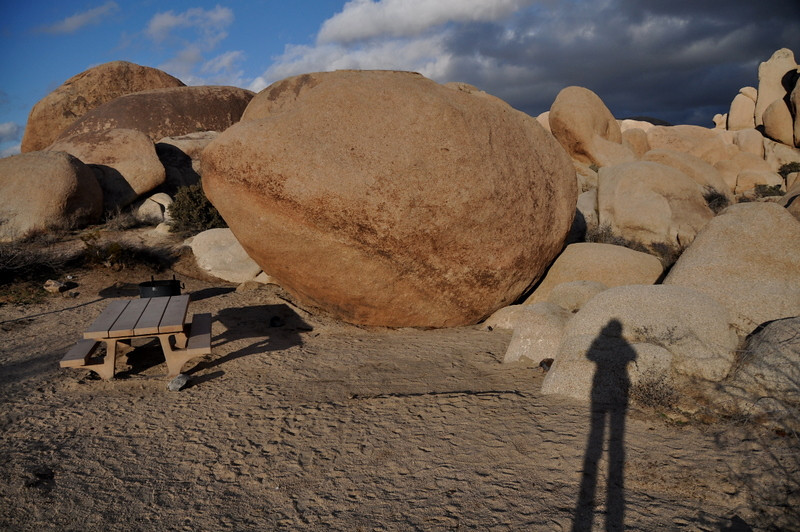 Our campsite (and my shadow). That big boulder helped a bit with the wind.