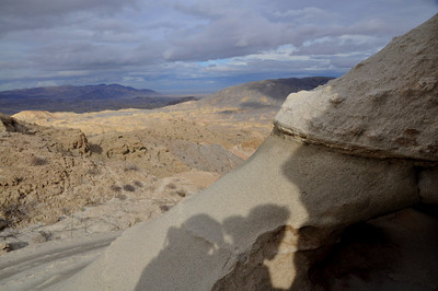 Shadow and view towards the Carrizo Badlands from the cave