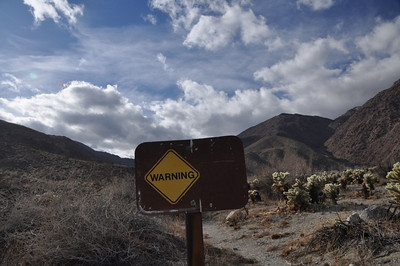 "Warning about.....??? On the hike back, someone had written in the dust on the sign: ""alien abductions ahead!"""