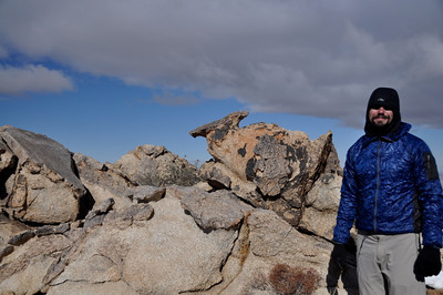 David bundled up on the summit. It was maybe in the low 30s by now with a nice strong wind. Brrrrrr.