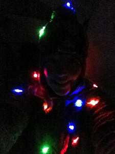 Playing with christmas lights around the campfire on Friday night.
