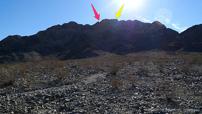 The pink arrow points at the notch and the yellow at the summit. The sun is at a bad angle for showing the route right now, but I'll get a good shot of it on the way back.
